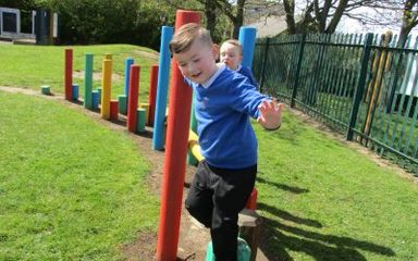 Nursery children have fun outdoors