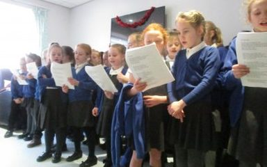 Carol Singing at the QE